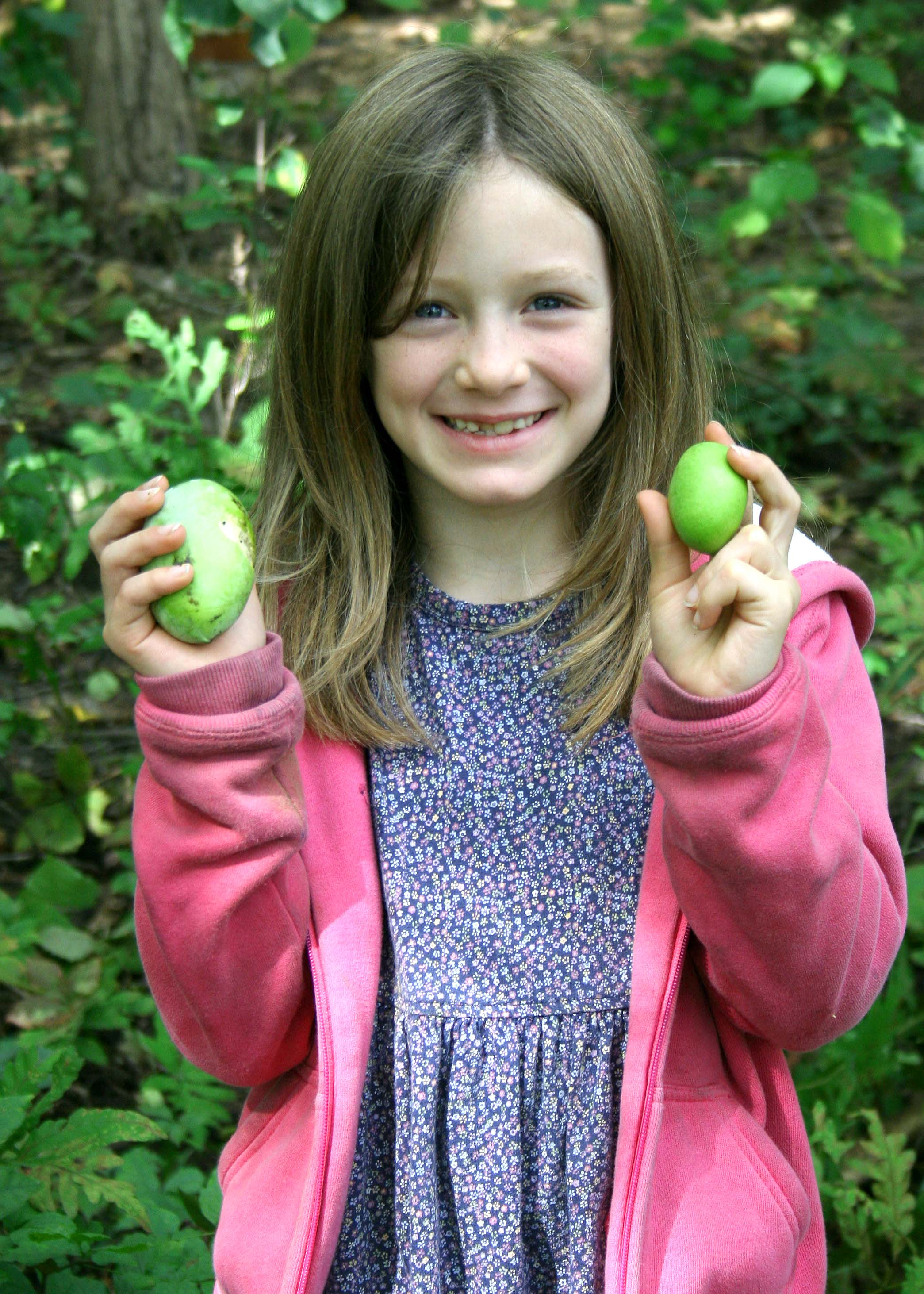 girl with pawpaw fruit